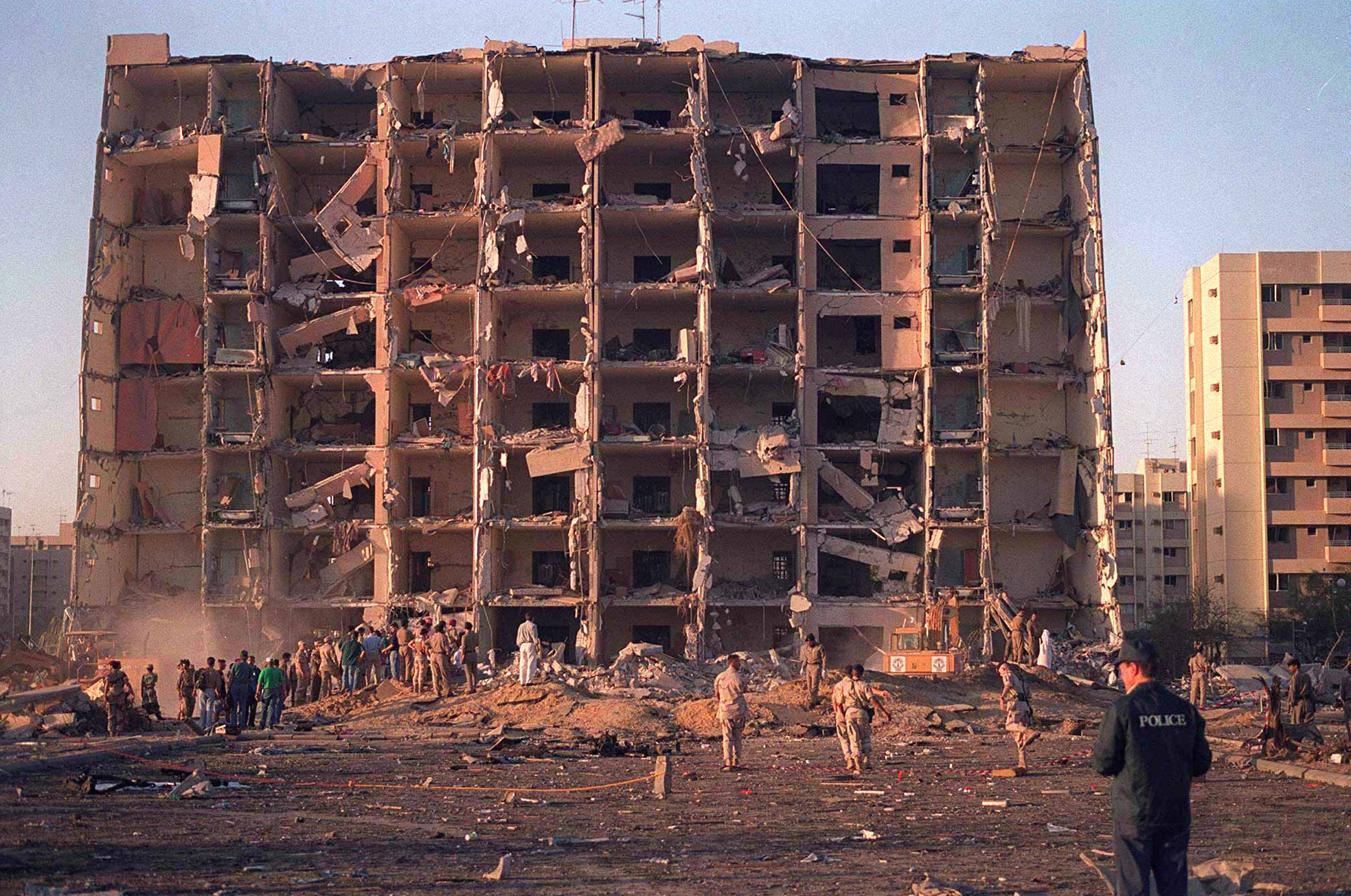 960626-N-00000-002 U.S. and Saudi military personnel survey the damage to Khobar Towers caused by the explosion of a fuel truck outside the northern fence of the facility on King Abdul Aziz Air Base near Dhahran, Saudi Arabia, at 2:55 p.m. EDT, Tuesday, June 25, 1996. Several buildings were damaged and there were numerous U.S. casualties. The latest information from Dhahran indicates that 19 people are dead and 64 people are hospitalized. Additionally, over 200 have been treated for injuries and released. The facility houses U.S. service members and serves as the headquarters for the U.S. Air ForceÕs 4404th Wing (Provisional), Southwest Asia. DoD photo.